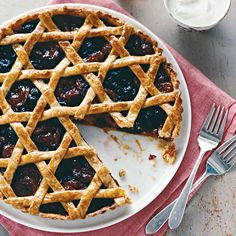 Strips of pate brisee woven in the style of classic chair caning give a twist to the familiar lattice-topped tart (the star pattern is easier to make than it seems). Even the filling is a surprise!