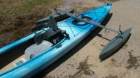 The adapted kayak features adjustable outriggers and a raised back with extra side supports
