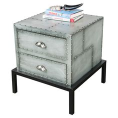 Metal cabinet with studded detail and a wood base. Product: Cabinet Construction Material: Wood and metal Color: Silver and black Features: Studded detail Dimensions: H x W x D Big Desk, Rock Fireplaces, Coffe Table, Exposed Wood, Wood Trim, Textured Walls, White Wood, Wood And Metal, Home Decor Accessories