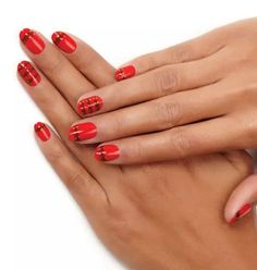 Shimmery, striped, and oh-so-bright, this manicure looks as deliciously red as a candy apple.  Get the tutorial on Essie »  - GoodHousekeeping.com