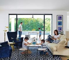 A simple palette makes pattern mixing foolproof. With soft, roomy seating, a generous rug, and flea-market touches (stools, side tables), the space is crisp enough for guests but casual enough for the boys.