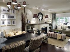 Living room and dining room: nice use of pattern, texture and contrast to lift this neutral room out of boring to cozy.