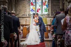 Bride and Grooms first kiss at Armitage Church, Staffordshire