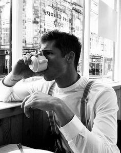Male model drinking coffee black and white photo