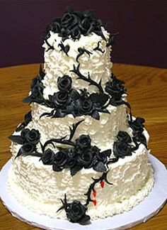 Gorgeous three tier black and white Goth style wedding cake, decorated with black sugar paste roses and thorns with just a hint of love. This cake is available from www.bethanylankin...