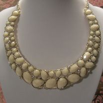 "New Fashion Bib Statement Necklace In White And Gold NOT FOR CHILDREN UNDER 12 With No Tags Type: Necklace Approximately 16"" Long    Materials:  Acrylic, Metal & Rhinestones     Condition: New Never Worn Free Delivery  No International Shipping  Nickel and Lead Compliant"