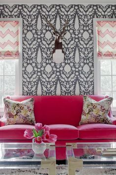 A bright pop of color is a surefire way to take any room's look from just functional to fun. If adding a hot pink sofa is too big of a step, start small and work in bold color with pillows or a throw. Grey Graphic Wallpaper, Charcoal Wallpaper, White Wallpaper, Pink Velvet Sofa, Pink Sofa, Red Sofa, Living Room Decor, Living Spaces, Dining Room