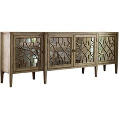 Perfect for displaying a lush floral arrangement or stowing board games and DVDs, this handsome sideboard showcases 4 mirrored doors with fretwork overlay.  ...