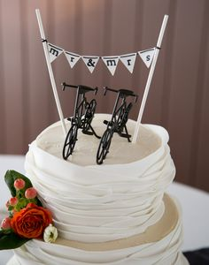 We love these white wedding cake bicycle toppers!