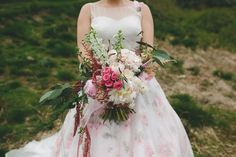 The beautiful pinks of the bouquet pick up the pink and green in this floral Wedding Dress #wedding #weddingday #bride #bridal #bridalstye #bouquet #sassiholford