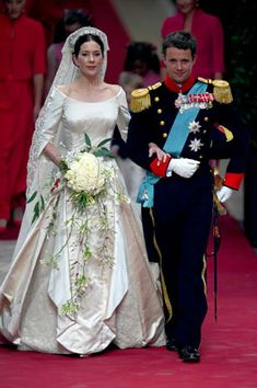 Royal Wedding -- Crown Princess Mary of Denmark.  Mary started living a real-life fairytale when she met Denmark's Crown Prince Frederik at a Sydney bar in 2000. The couple married in Copenhagen in 2004, with Mary choosing an ivory satin dress by Danish designer Uffe Frank and an heirloom lace veil first used by Crown Princess Margaret of Sweden in 1905.