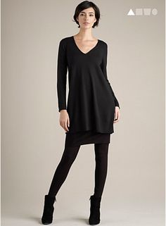 eileen fisher v neck tunic with skirt and tights and boots. Love the black on black on black!