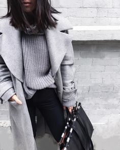 """Soft grey knits and cashmere coats. Black jeans and leather bags with metal detail. #nalielidaily"""