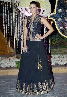 Neha Dhupia in black-golden lehenga choli at Manish Malhotra's niece's reception. #Bollywood #Fashion #Style #Beauty