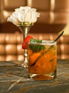 Basilico (1½ oz. citron vodka  ½ oz. peach liqueur  ¼ oz. apple liqueur  ¼ oz. simple syrup  ¼ oz. lime juice  1 strawberry  5 basil leaves  Garnish: strawberry)