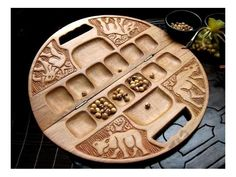 I'd rather hang it on a wall than play on it! A hand-carved wooden mancala board Games For Kids, Games To Play, Coffee Table Games, Mancala Game, Bored Games, Logic Games, Cnc, Go Game, Family Board Games