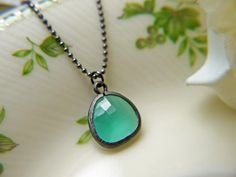 Mint Opal Glass Pendant Necklace In Gunmetal Finish.