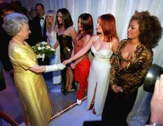 Queen Elizabeth turns 89: her life in photos - Queen Elizabeth II, left, shakes hands with Geri Halliwell, (Ginger Spice), of the pop group Spice Girls as Mel B, right, looks on after the group's Royal Variety performance in London's Victoria Palace Theatre on Monday, Dec. 1, 1997.