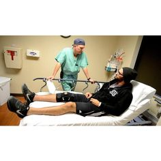 Seth Rollins undergoes surgery photos ❤ liked on Polyvore featuring wwe