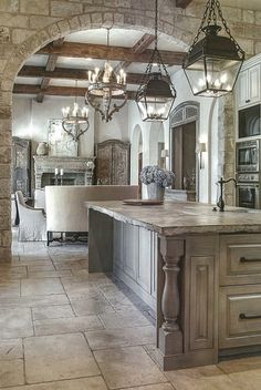 Liking the stone, floor tiles, washed cabinetry, kitchen lights ... nice old world look. More home designs at www.HomeChannelTV.com