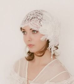 The Juliet Cap Veil was the common name for this style in the 1920s though its origins and name are taken from Shakespeare's Romeo and Juliet. Here's a lovely Juliet cap from Erica Elizabeth Design on Etsy.