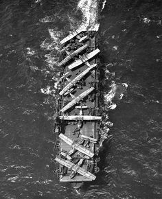 Escort carrier USS Thetis Bay transporting aircraft to Alameda California for repair 1944.