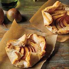 Sheets of crisp, paper-thin phyllo dough encase a filling of toasted ground almonds, with red-skinned pears as the crowning touch. We call for Anjou, Pear Recipes, Fall Recipes, Snack Recipes, Dessert Recipes, Cooking Recipes, Pear Tart, Tart Shells, Phyllo Dough, Cooking Light
