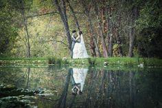 Reflection shot of bride and groom. Iris Wedding Gardens in Camino, CA (Apple Hill area).
