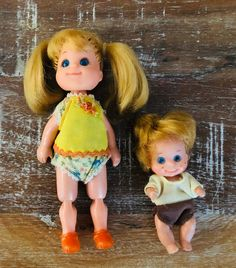 Blonde-haired Sweets Sunshine had ribbons in her ponytails and wore a cute yellow jumper with matching orange shoes. The freckle-faced baby donned a jumper with a white top and brown shorts that matched the Dad's new outfit.