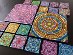 Hand-painted Mandala on a canvas on a wooden frame of 20 x20 cm (7.85 ) and 1.5 cm deep. Starting in a single central point is created this unique two-dimensional mandala, with pointillism technique, advancing point by point and until completing the entire canvas, in vivid colors