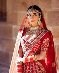 Looking for A bride dressed in a red Sabyasachi lehenga on her wedding day? Browse of latest bridal photos, lehenga & jewelry designs, decor ideas, etc. on WedMeGood Gallery. Indian Bridal Outfits, Indian Bridal Lehenga, Indian Bridal Fashion, Indian Bridal Makeup, Bridal Dresses, Red Wedding Lehenga, Bridal Dupatta, Designer Bridal Lehenga, Wedding Hijab