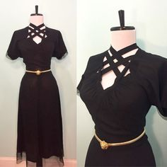 Absolutely gorgeous black rayon 1940s dress featuring a unique peekaboo criss-cross neckline and sheer chiffon trim along the bottom of the
