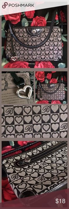 """Brighton Heart Handbag Brighton heart handbag. Gray and black. Has key leash and three zippers. The bag looks and feels new besides having small unnoticeable scuff marks on the corners. 10.5"""" X 6.5"""". Nice little details inside the bag. Numbered in leather. Leather parts. Heavy hardware heart. Looks a little aged up close but still shiny. I was unfamiliar with this co. and googled it. They have some nice quality, pricey, cute things there. Thanks for looking! Brighton Bags Shoulder Bags"""