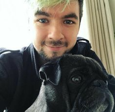 oh my God he's so cute! so is the dog
