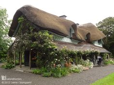 This is Swiss Cottage in Kilcommon, South Tipperary in the heart of Ireland. It was built in 1810, a fine example of a style called ornée, or ornamental cottage. The cottage, with its roundwood pillars, was designed by the architect John Nash. Find more natural homes at www.naturalhomes.org