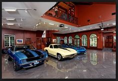 Dream garage with 3 exotic cars! Check out this garage built right into the home! Polished concrete floors and hardwood walls surround this two-level garage, or Garage Loft, Dream Car Garage, Garage Shop, Clean Garage, Organized Garage, Garage Workshop, Design Garage, Garage Pictures, Ultimate Garage