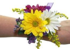 Daisey Wrisr Corsage---White, Yellow & Purple Daisies accented with GoldenAster, Daisy Buttons & Misty Purple creates a charming corsage that looks best with Citrus colored gowns! (Shown on LAVENDER Ribbon/Wristlet!) (Matching Boutonniere: