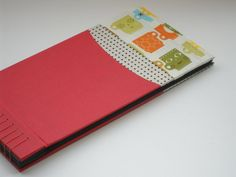love the closely spaced binding, black paper, and funky print #bookbinding