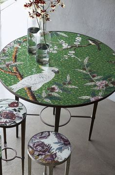 The Greeks elevated mosaic tile work to an art form in the fourth century and our intricately inlaid round table is the modern expression of that spirit. Thousands of colored glass fragments are scrupulously assembled by master artists to create this gorgeous image of birds and blossoms.