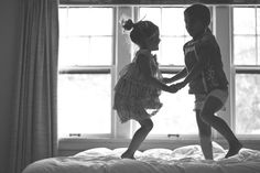finding the light - natural light, lifestyle photography — Charis Rowland Photography, sisters, jumping on bed, silhouette, backlit