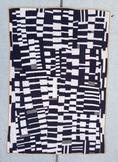 Littleneck throw quilt | black and white handmade hand-sewn improv modern quilt by zakfostershop on Etsy https://www.etsy.com/listing/197886362/littleneck-throw-quilt-black-and-white