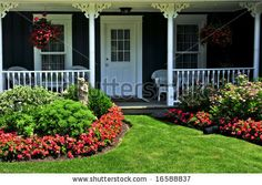 Gorgeous Landscaping Front yard photo | Landscaped front yard of a house with flowers and green lawn - stock ...