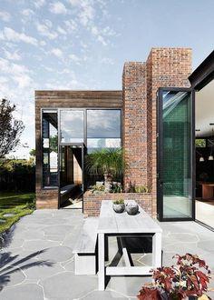 Modern brick, wood, and glass home