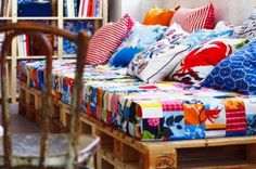 Make a kids bed with a mattress on pallets!  The pallets are also a great place to store shoes, toys, etc. under the bed in a organized way.