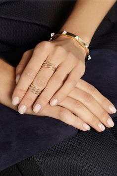 Nude nails.....love the rings too!!