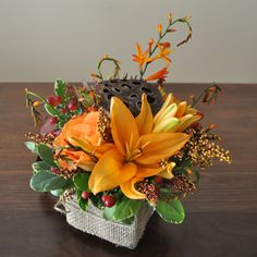 A cute petit floral arrangements in braun-orange colors #1.
