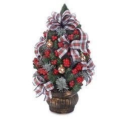 """$69.00-$75.00 Waterford White Stewart Plaid Table Tree - 19"""" HeightThe White Stewart Plaid Collection features pre-lit/pre-decorated home decor pieces. The collection boasts gorgeous faux greenery decorated with berries, hand-painted glass ornaments and rich textured ribbon. Each piece is beautifully gift packaged for the holiday season. The White Stewart Plaid Table Tree features a weathered br ..."""