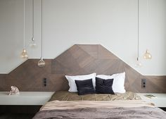 Headboard Design Idea – Create A Landscape Design From Wood Olga Khovanskaya of Moscow-based MOPS architecture studio, got creative and included a custom wood headboard in the design of this bedroom.