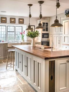 Rustic elements add layers of warmth that complement this kitchen's on