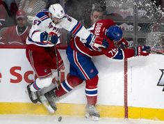 New York Rangers left wing Benoit Pouliot, left, collides with Montreal Canadiens defenceman P.K. Subban along the boards during second peri...